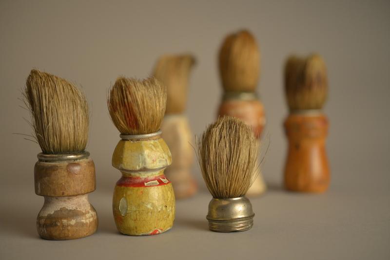 Brochas de afeitado pertenecientes a víctimas transportadas a Auschwitz. Colección del Museo Estatal de Auschwitz-Birkenau - Foto por Pawel Sawicki © Auschwitz-Birkenau State Museum - Musealia